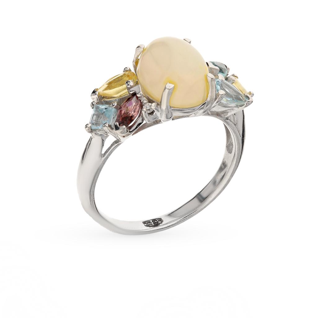 Фото «серебряное кольцо с фианитами, опалами синтетическими, топазами синтетическими, цитринами синтетическими и родолитами синтетическими»