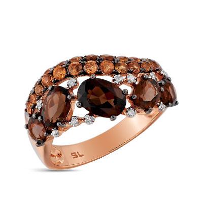 Фото «Золотое кольцо с раухтопазами, гранатом и бриллиантами»