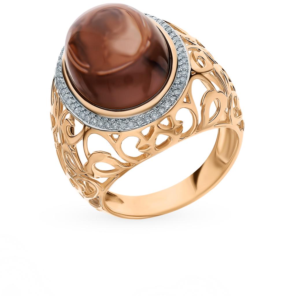 золотое кольцо с раухтопазами и бриллиантами
