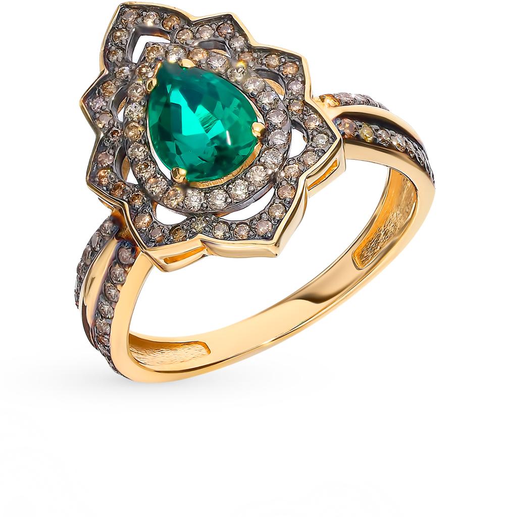 Золотое кольцо с коньячными бриллиантами и изумрудом