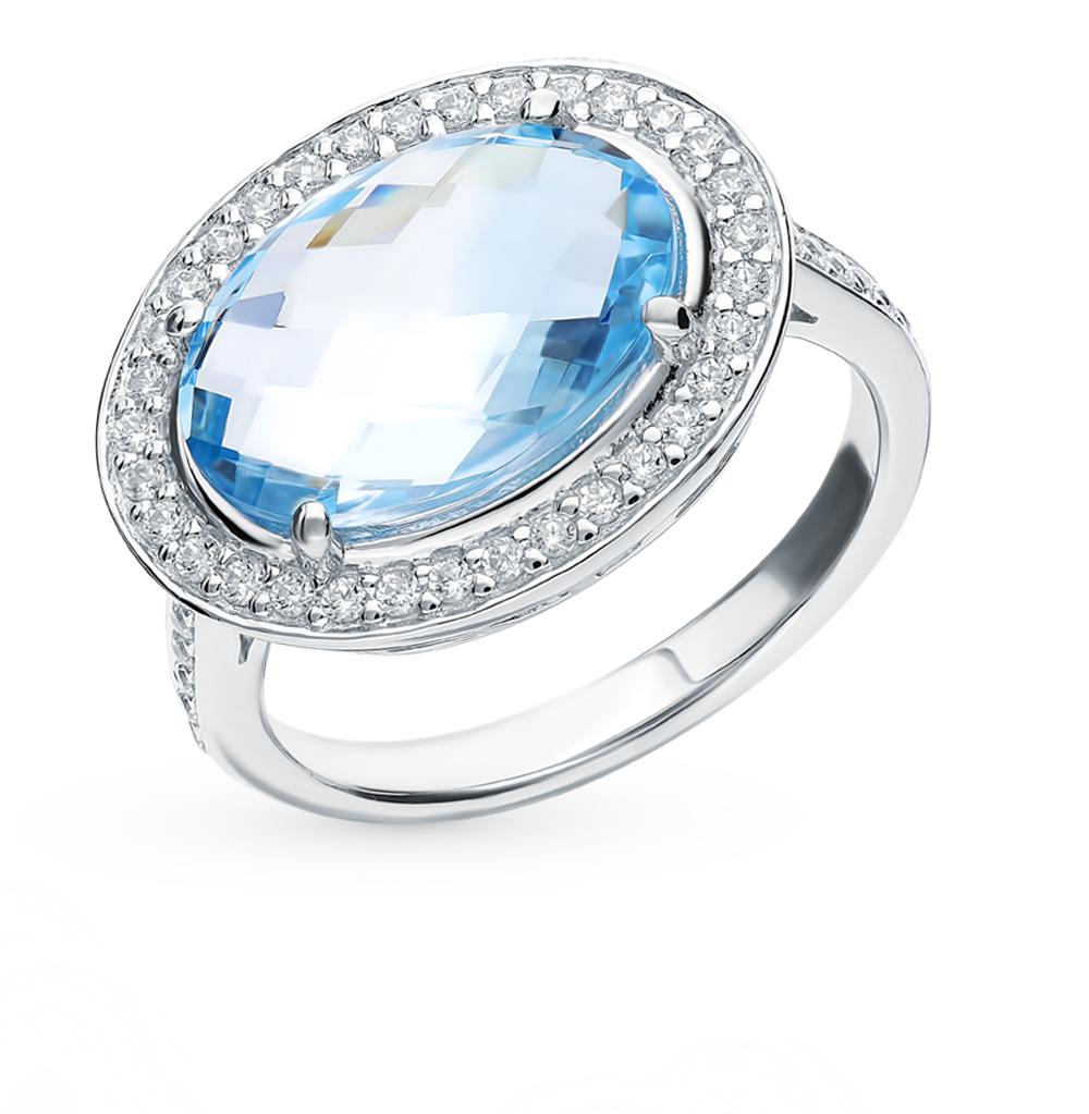Фото «Серебряное кольцо с топазом и фианитами»