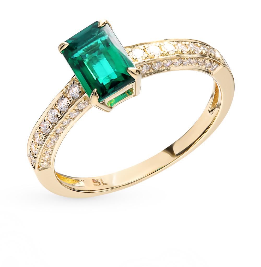 золотое кольцо с изумрудами и бриллиантами