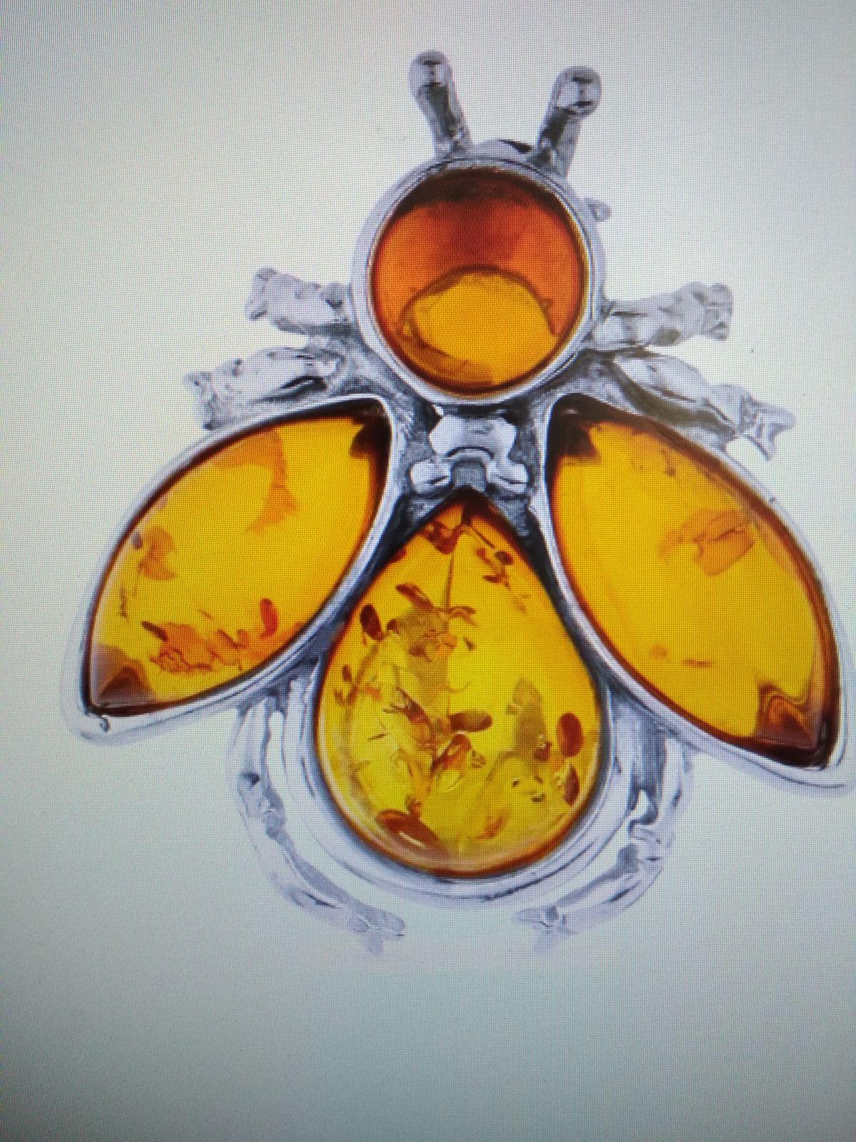 Серебряная брошь с янтарем с началом весны