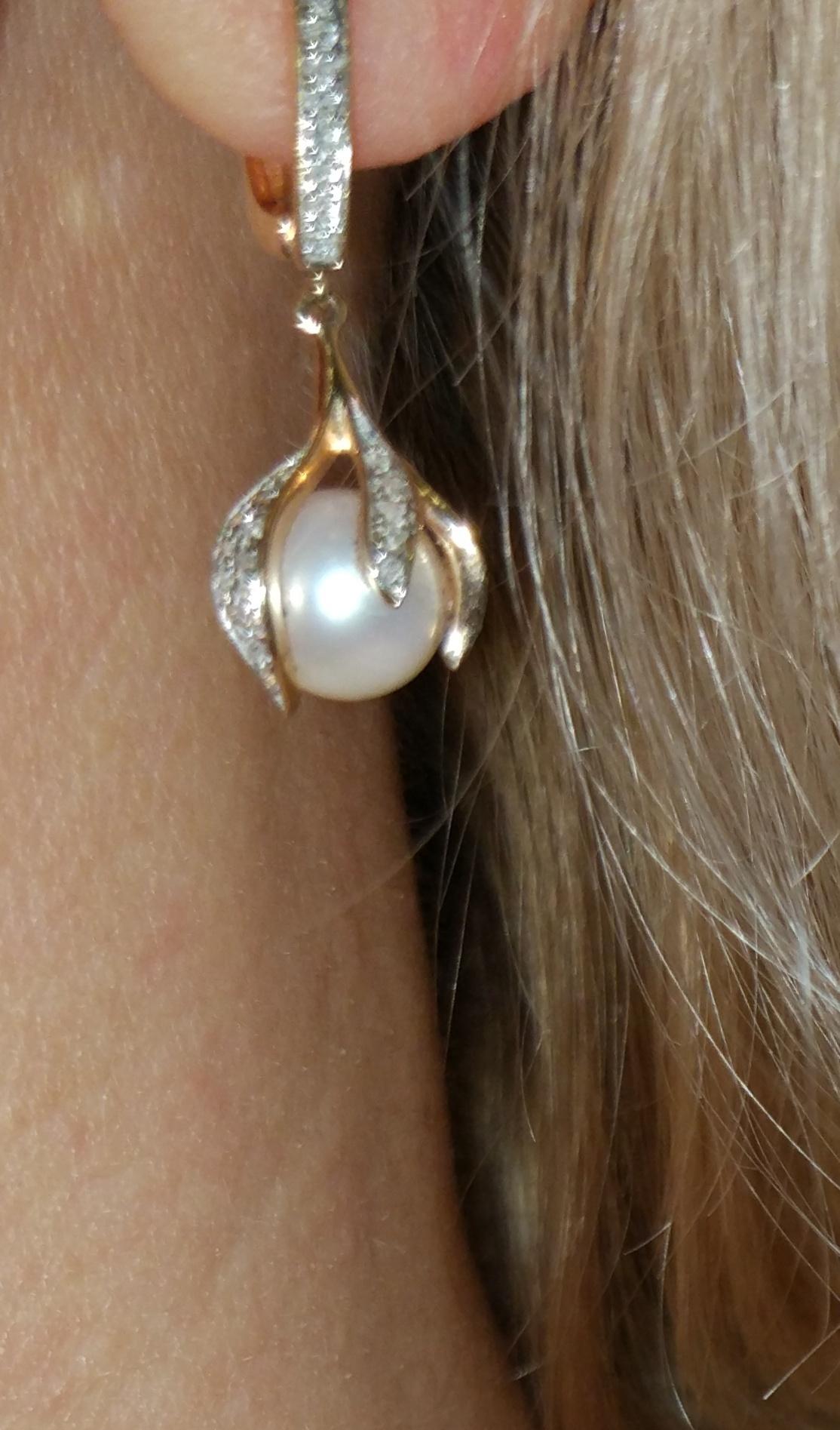 Серьги с бриллиантами и жемчужиной.
