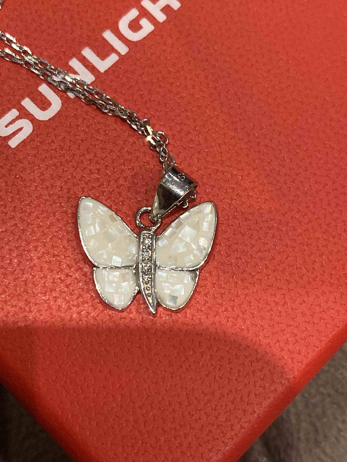 Очень нежная бабочка