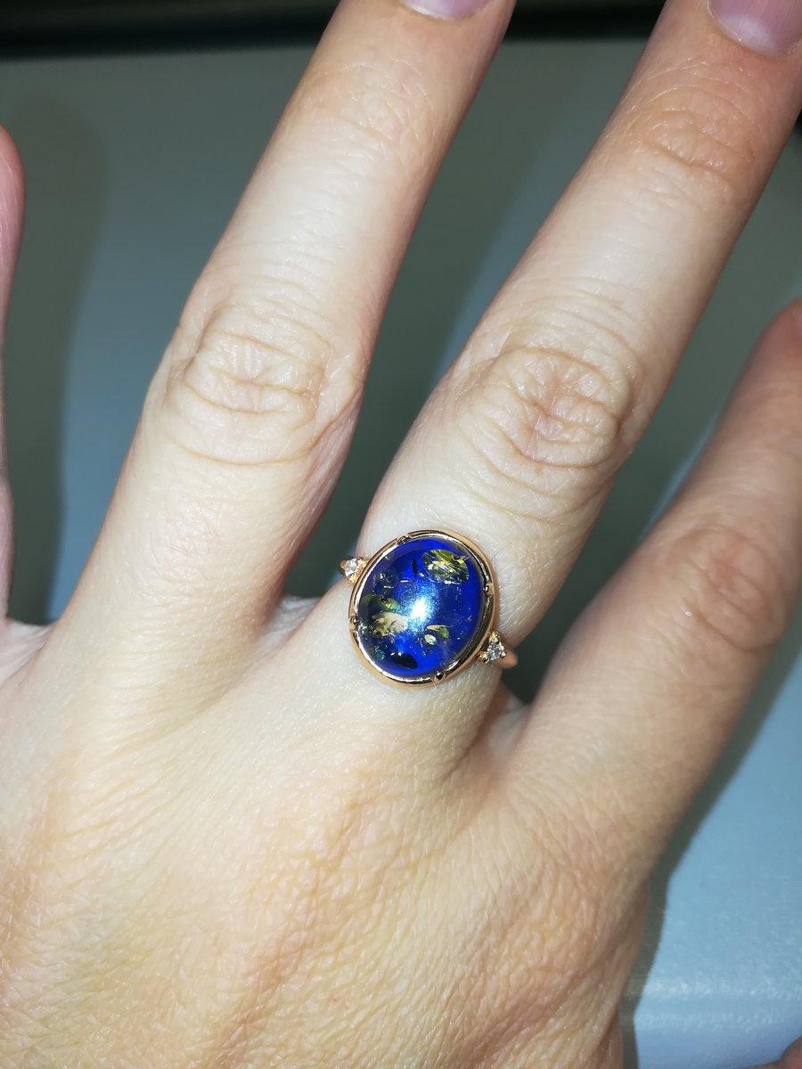 Серебряное кольцо с фианитами и январем
