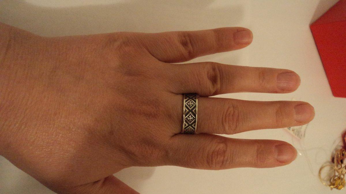 Серебряное кольцо с символами