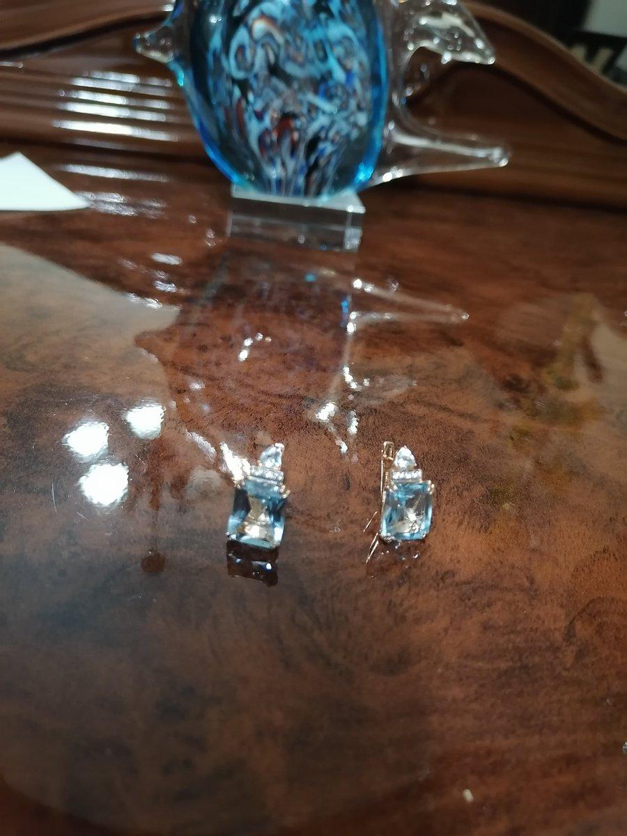Серьги с голубыми топазами