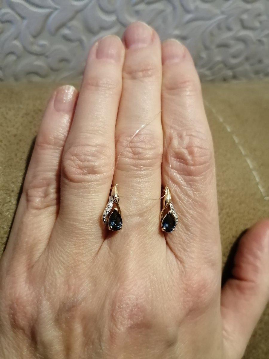 Сережки с лондон топазами и бриллиантами.