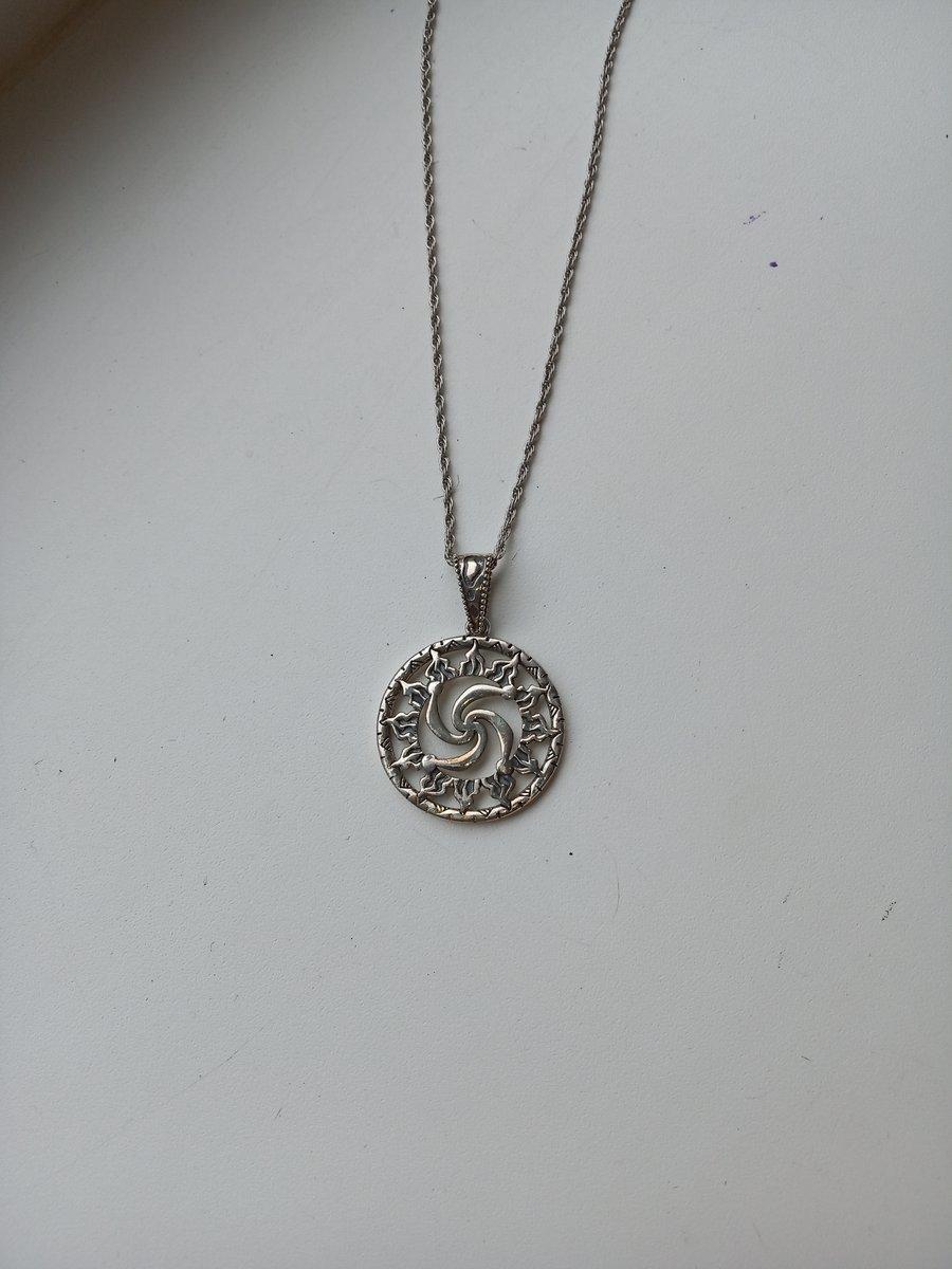 Символ рода в солнце