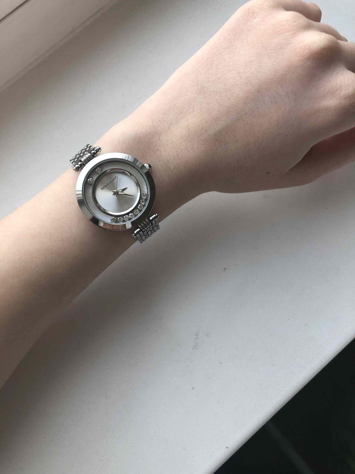 Женские часы с тансующими кристаллами